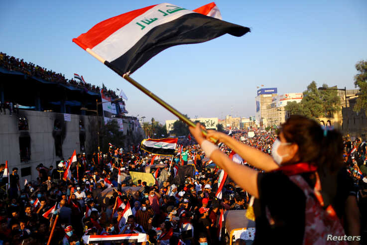 An Iraqi female demonstrator waves an Iraqi flag during an ongoing anti-government protest, in Baghdad, Iraq November 1, 2019…