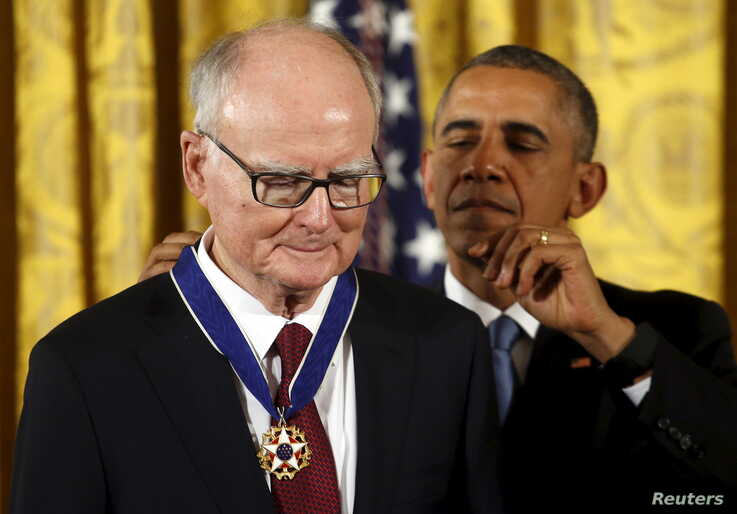 U.S. President Barack Obama presents the Presidential Medal of Freedom to attorney William Ruckelshaus during an event in the…