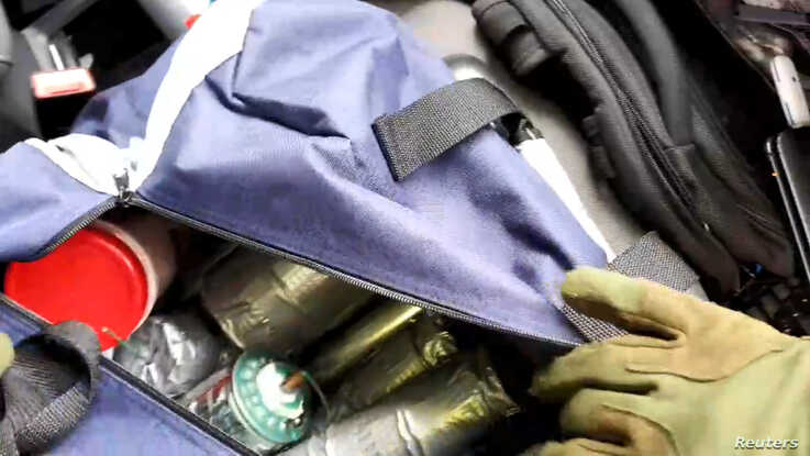 Apparent explosives cache is seen in a bag inside the vehicle used by a gunman in an attack on a synagogue in Halle, Germany…