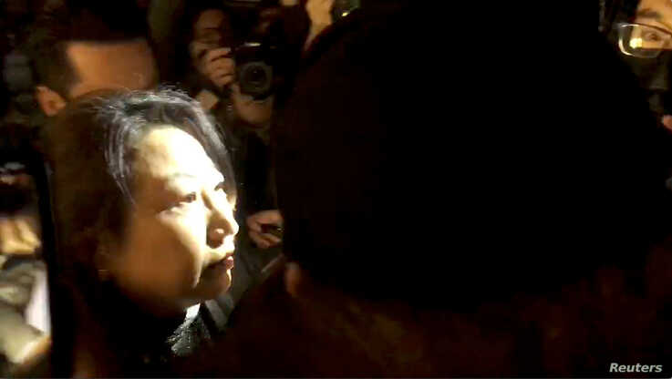 Hong Kong Justice Secretary Teresa Cheng walks as protesters surround her in London, Britain November 14, 2019, in this still…
