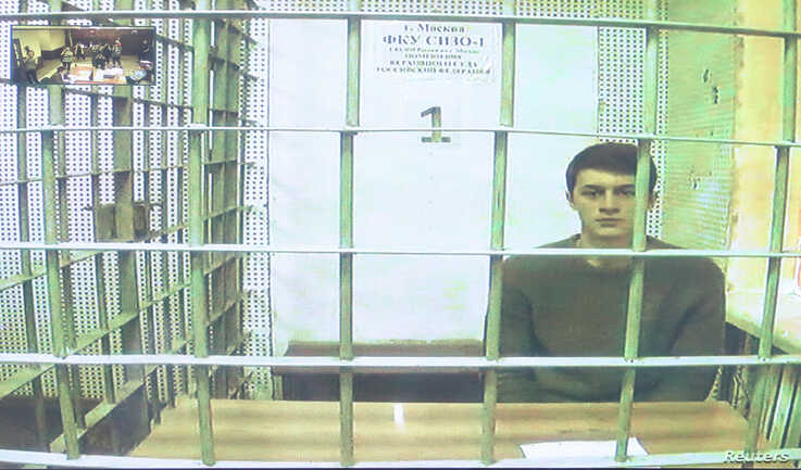 Student and blogger Yegor Zhukov, who was detained during a recent protest for fair elections, is seen on a screen via a video…