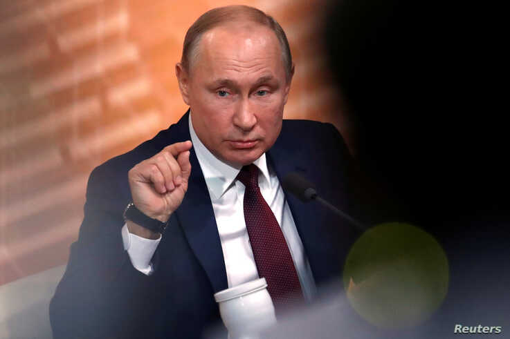 Russian President Vladimir Putin gestures during his annual end-of-year news conference in Moscow, Russia December 19, 2019…