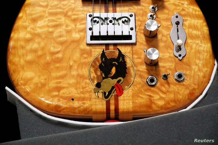 "Late Grateful Dead front man Jerry Garcia's custom-made ""Wolf"" Guitar, displayed here by Guernsey's Auctions, which plans to…"