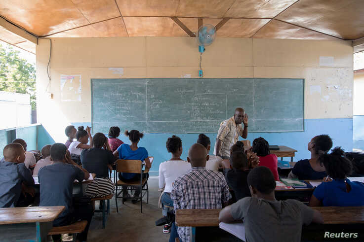 Franz Merisier teaches a Spanish class at the College Saint Pierre-Eglise Episcopale D'Haiti as schools and businesses…