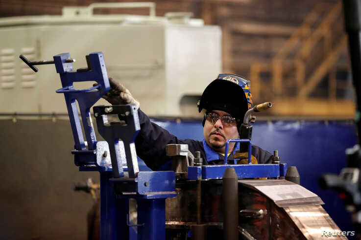 A LB Steel LLC's employee manufactures a component for new Amtrak Acela trains built in partnership with Alstom in Harvey,…