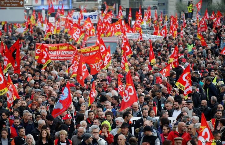 French Labour unions members attend a demonstration against French government's pensions reform plans in Marseille as part of a…