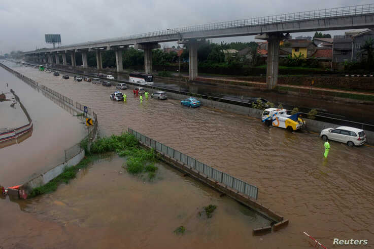General view during a flood after heavy rain in Bekasi, near Jakarta, Indonesia January 1 2020, in this photo taken by Antara…