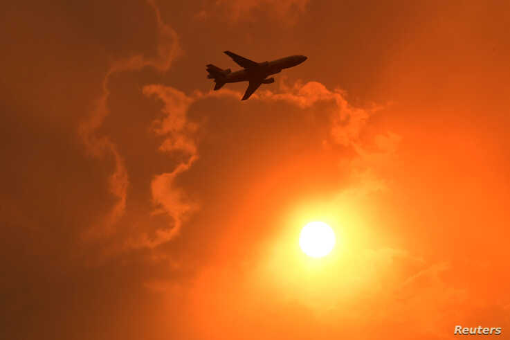 A DC-10 Air Tanker makes a pass to drop fire retardant on a bushfire in North Nowra, south of Sydney, Australia, January 4,…