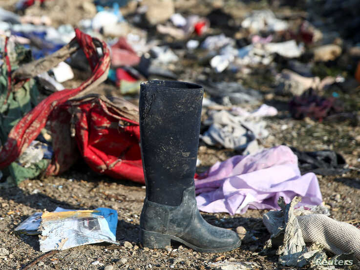 Passengers' belongings are pictured at the site where the Ukraine International Airlines plane crashed after take-off from Iran…