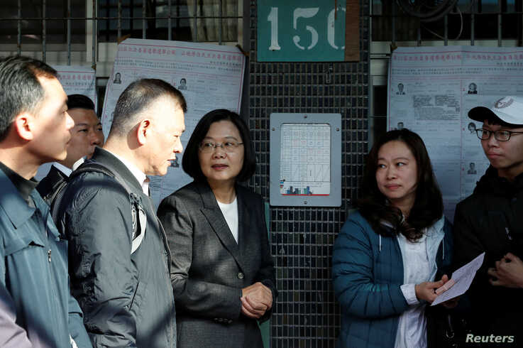 Taiwan President Tsai Ing-wen arrives to cast her vote at a polling station during general elections in New Taipei City, Taipei…