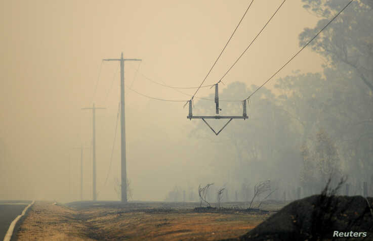 Burnt power lines are seen in Mallacoota, Victoria, Australia January 10, 2020. Picture taken January 10, 2020. REUTERS/Tracey…