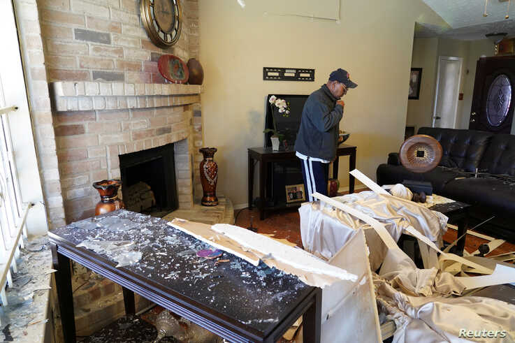 Juan Diaz, 62, stands inside his house, damaged by a warehouse explosion nearby in Houston, Texas, U.S., January 24, 2020. The…