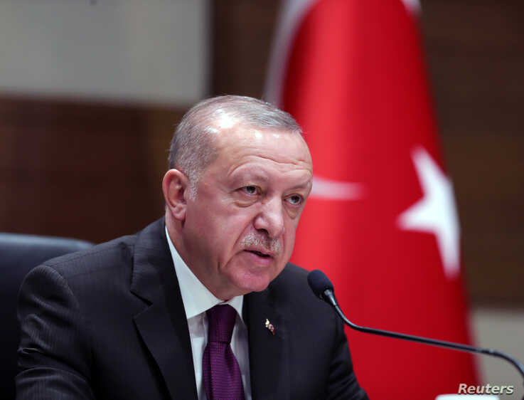 Turkish President Tayyip Erdogan speaks during a news conference ahead of a visit to Algeria, at Ataturk airport in Istanbul,…