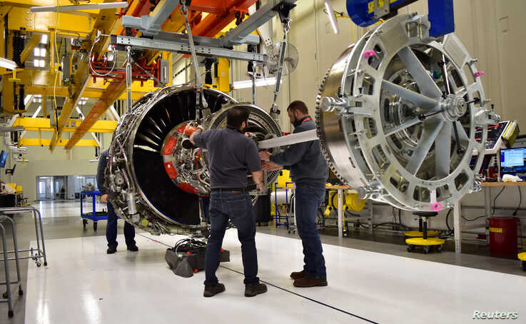 Technicians build LEAP engines for jetliners at a new, highly automated General Electric (GE) factory in Lafayette, Indiana, U…