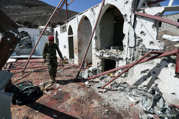 A soldier walks at the site of a Houthi missile attack on a military camp's mosque in Marib, Yemen January 20, 2020. REUTERS…