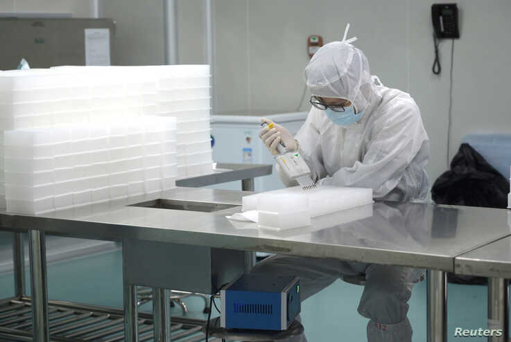 A technician works in a laboratory for manufacturing testing kits for the new coronavirus at a medical laboratory company Da An…