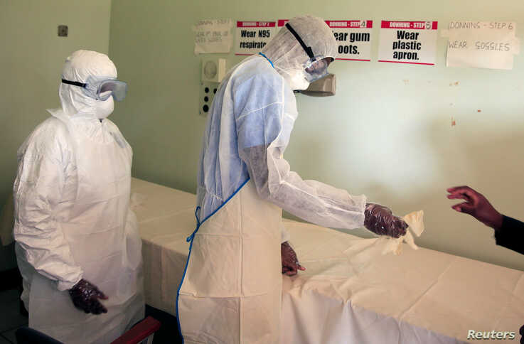 Zimbabwe's health workers wear protective suits during a training exercise aimed at preparing workers to deal with any…