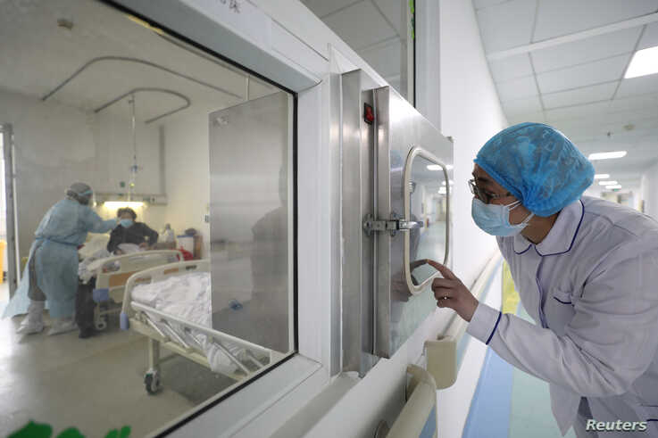 A medical worker calls his colleague inside an isolated ward at Jinyintan Hospital in Wuhan, the epicentre of the novel…