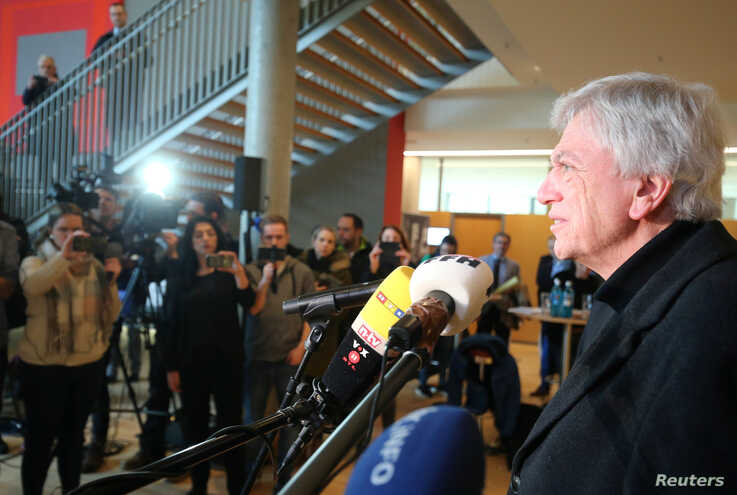 Hesse's state Premier Volker Bouffier speaks during a news conference with Hanau Mayor Claus Kaminsky (not pictured) following…