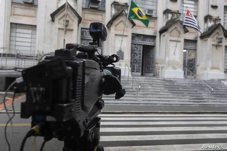 A tv camera sits in front of Adolfo Lutz Institute which is responsible for double checking the coronavirus test results in Sao…