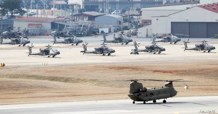 A helicopter prepares to take off at a U.S. army base in Pyeongtaek, South Korea, February 27, 2020.    Yonhap via REUTERS  …