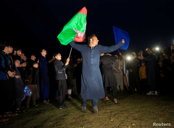 Afghan youth dance and peace activists gather as they celebrate the reduction in violence, in Jalalabad, Afghanistan February…