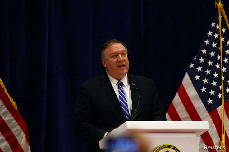 U.S. Secretary of State Mike Pompeo speaks during a news conference after a signing ceremony between members of Afghanistan's…