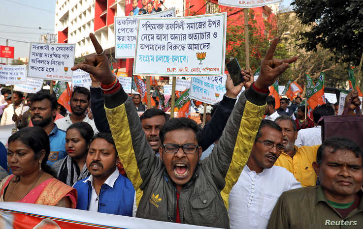 Supporters of India's ruling Bharatiya Janata Party (BJP) shout slogans during a rally in support of a new citizenship law, in…