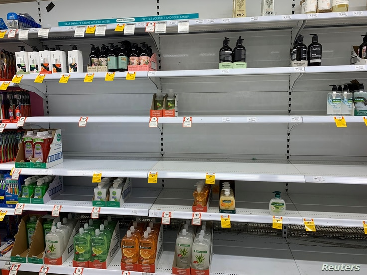 Empty shelves are pictured at Coles Supermarket following reports of coronavirus in the Canberra suburb of Manuka, Australia,…