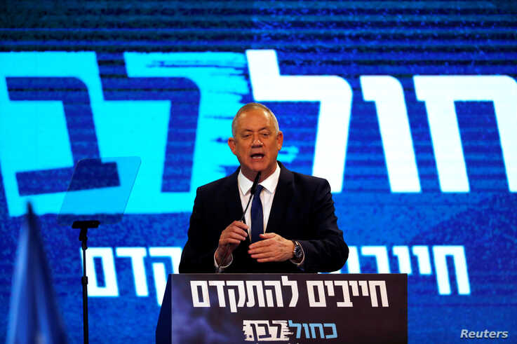Blue and White party leader Benny Gantz speaks to supporters following the announcement of exit polls in Israel's election at…
