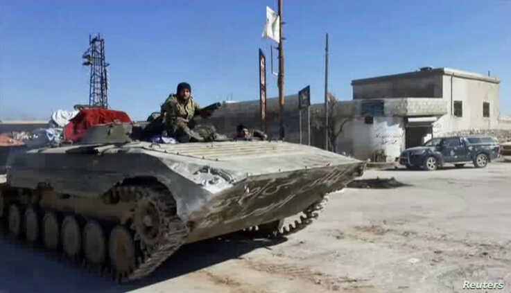 A still image taken from a video obtained by Reuters and shot on March 2, 2020, shows Syrian army soldiers advancing on the…