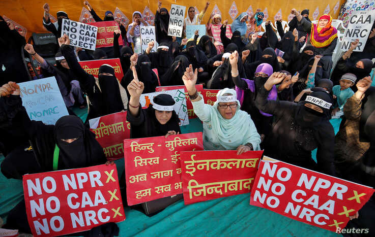 Demonstrators shout slogans during a protest against a new citizenship law, in Ahmedabad, India, March 3, 2020. REUTERS/Amit…