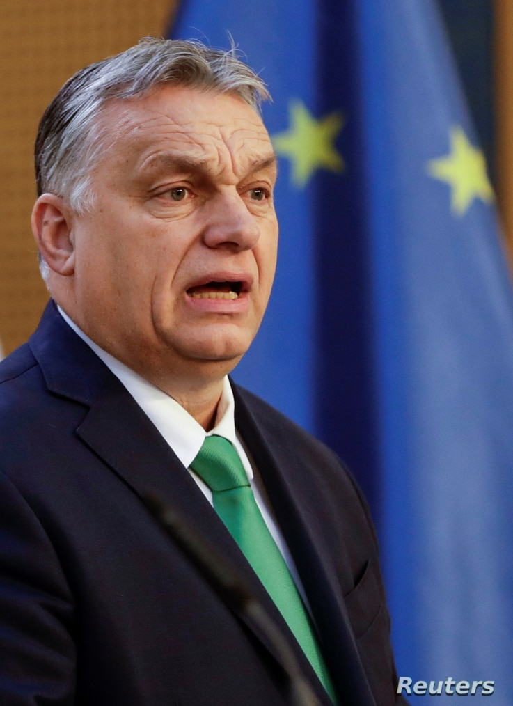 Hungary's Prime Minister Viktor Orban speaks as he attends a news conference during the summit of the Visegrad Group (V4)…