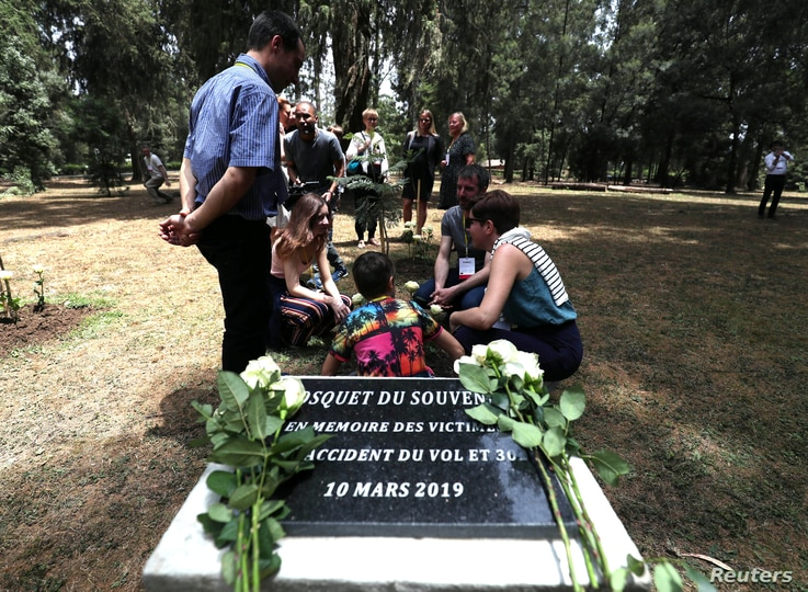 A monument for the victims of the Ethiopian Airlines Flight ET302 Boeing 737 Max plane crash is seen during a memorial ceremony…