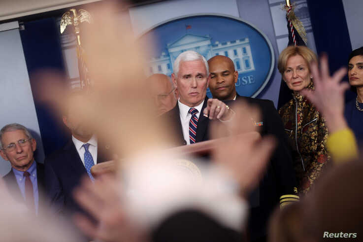 U.S. ‪Vice President Mike Pence‬ takes questions during a news briefing on the administration response to the Coronavirus, at…