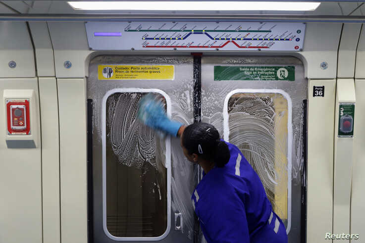 A cleaner works on the disinfection of a subway train as a measure against the coronavirus disease (COVID-19) in Sao Paulo,…