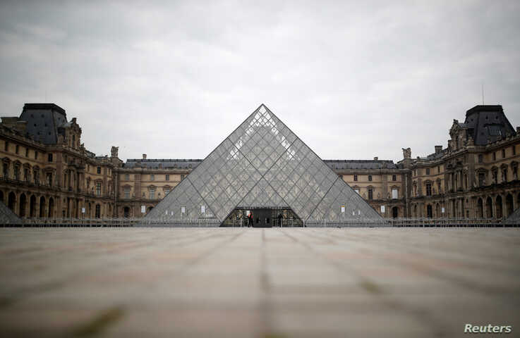 A view shows the deserted area in front of the glass Pyramid of the Louvre museum in Paris as a lockdown is imposed to slow the…