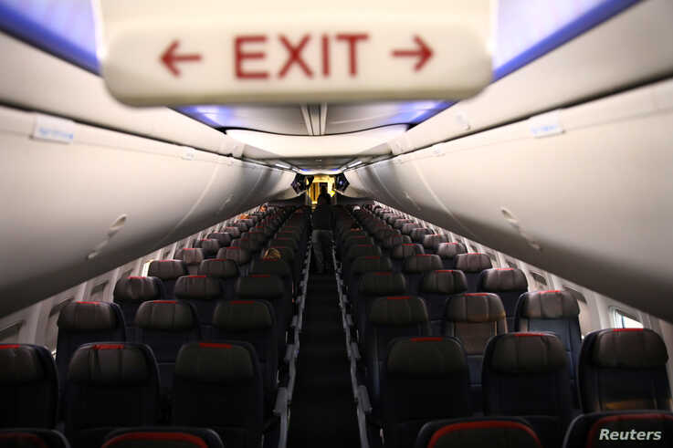 Rows of empty seats of an American Airline flight are seen, as coronavirus disease (COVID-19) disruption continues across the…