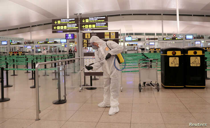 A member of the Military Emergency Unit (UME) disinfects the Josep Tarradellas Barcelona-El Prat Airport during a partial…