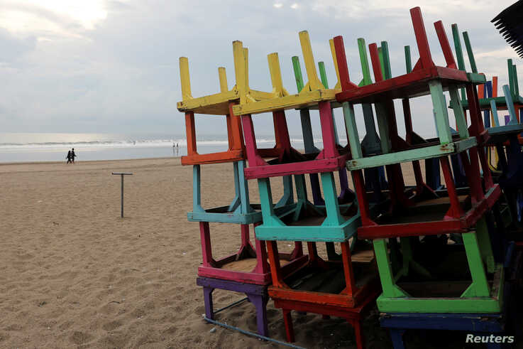 Stacked up tables are pictures outside a beach restaurant closed amid the spread of coronavirus disease (COVID-19) at Seminyak…