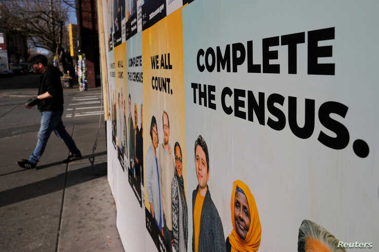 Signs advertising the 2020 U.S. Census cover a closed and boarded up business amid the coronavirus disease (COVID-19) outbreak…