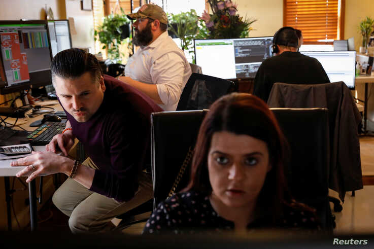 Thea D'Adamo, Head of Options Execution at TradeMas Inc., works with fellow NYSE-AMEX floor traders Paul in an off-site trading…
