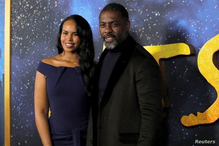 "Actor Idris Elba (R) and his wife Sabrina Dhowre Elba (L) arrive for the world premiere of the movie ""Cats"" in Manhattan, New…"
