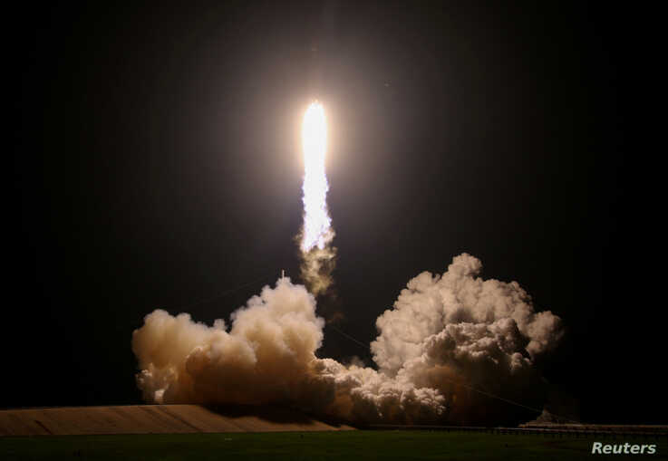 FILE PHOTO: A SpaceX Falcon Heavy rocket, carrying the U.S. Air Force's Space Test Program-2 mission, lifts off from the…