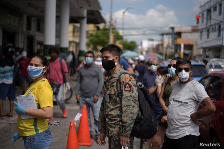 People wait in line to buy supplies amid the spread of the coronavirus disease (COVID-19), in Guayaquil, Ecuador April 2, 2020…