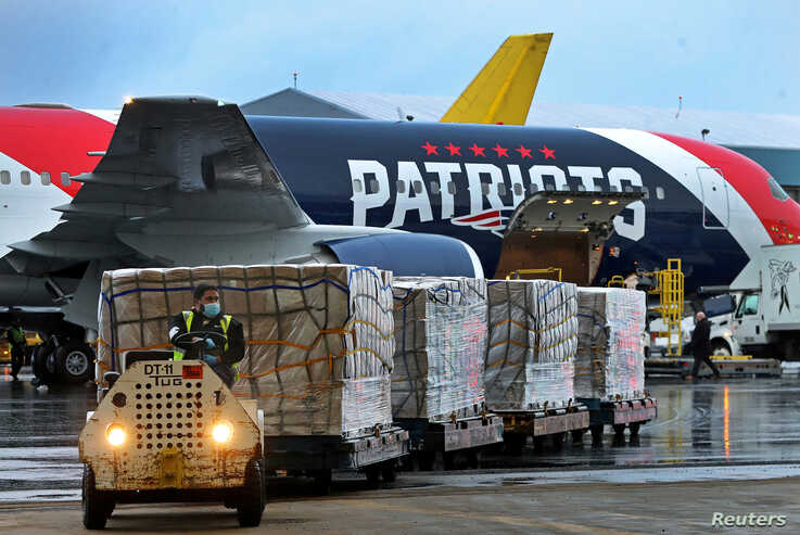A New England Patriots Boeing 767-300 jet with a shipment of over one million N95 masks from China, which will be used in…