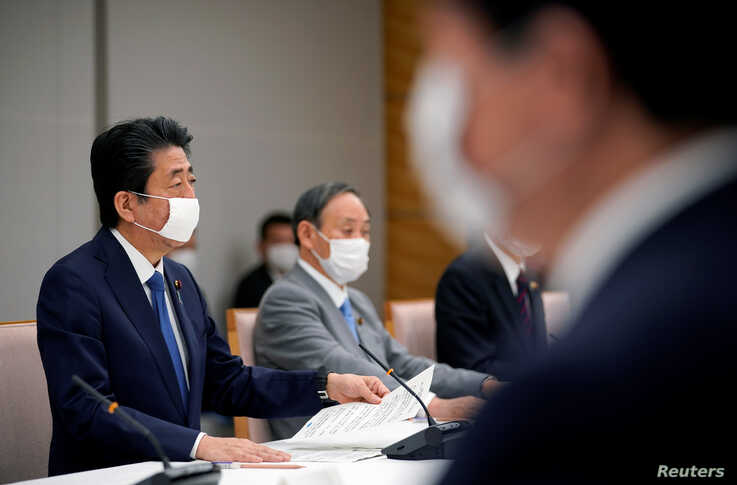 Japan's Prime Minister Shinzo Abe speaks during a meeting about the measures against the coronavirus disease (COVID-19), at the…