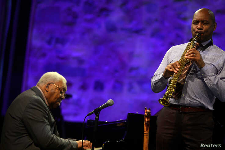 U.S. saxophonist Branford Marsalis (R) performs with his father Ellis Marsalis at the 51st Jazzaldia Jazz Festival in San…