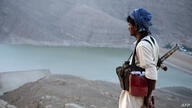 An armed Yemeni tribesmen from the Popular Resistance Committees, supporting forces loyal to Yemen's Saudi-backed fugitive President Hadi, stands overlooking the great Dam of Marib, east of the capital Sanaa, during ongoing clashes with Shiite Huthi re...