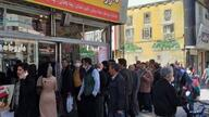 A line of customers in front of a drug store in Iran,